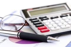 Tax calculator pen and glasses Royalty Free Stock Photography