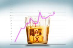 Tax. Chart the ratio of tax rates that increases with increasing income and wealth, nuanced tax words on ice cubes in a glass of. Water. Isolated on blue shadow stock photo