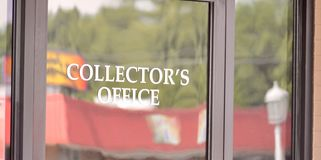 Tax Collectors Office. A tax collector or a taxman is a person who collects unpaid taxes from other people or corporations stock photo
