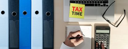 Tax Concept Business analyzing Individual income tax return form. Concept stock photo