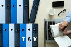 Tax Concept Business analyzing Individual income tax return form. Concept stock photos