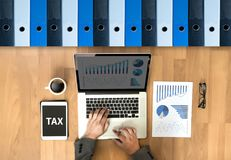Tax Concept Business analyzing Individual income tax return form. Concept royalty free stock image