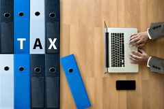 Tax Concept Business analyzing Individual income tax return form. Concept stock image