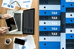 Tax Concept Business analyzing Individual income tax return form. Concept royalty free stock photography