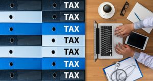 Tax Concept Business analyzing Individual income tax return form. Concept royalty free stock images