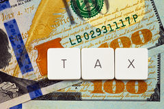 Tax concept - letter tag on money background Stock Photo