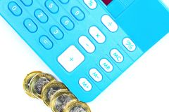 Tax or cost calculation. Gold , and silver coins beside calculator.  Concept for tax , cost , budget , bill , profit ,revenue calculation etc Stock Photography
