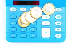 Tax or cost calculation. Gold , and silver coins on calculator.  Concept for tax , cost , budget , bill , profit ,revenue calculation etc Stock Photo