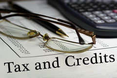 Tax and credits Stock Image