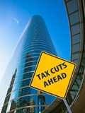 Tax Cuts Ahead. Sign in front of a corporate building royalty free stock photography