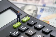 Tax cuts or reduce concept, miniature people business man presid Stock Photos