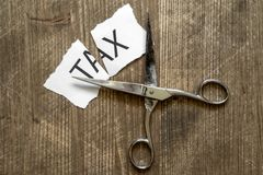 Tax cuts and saving people money Royalty Free Stock Photography