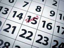 Tax day. Taxes written in red on the 15th day of a calendar Royalty Free Stock Images