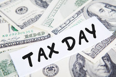 Tax Day. Taxes concept with money and text of tax day Stock Photos