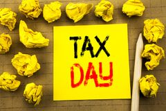 Tax Day. Business concept for Income taxation Refund written on sticky note paper on the vintage background. Folded yellow papers. Tax Day. Business concept for royalty free stock photography