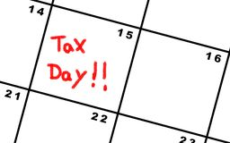 Tax day on a calendar. Wrote in red Royalty Free Stock Images