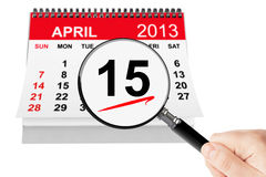 Tax Day Concept. 15 april 2013 calendar with magnifier on a white background Royalty Free Stock Photo