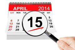 Tax Day Concept. 15 april 2014 calendar with magnifier on a white background Stock Images