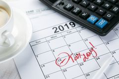 Tax day concept - calculator, calendar, tax form royalty free stock images