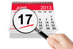 Tax Day Concept. 17 june 2013 calendar with magnifier on a white background Royalty Free Stock Images