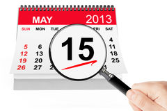 Tax Day Concept. 15 may 2013 calendar with magnifier on a white background Stock Image