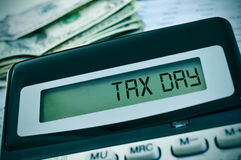 Tax day in the display of a calculator Stock Images