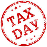 Tax day red rubber stamp Royalty Free Stock Photos