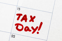`tax day` is a text written on the calendar, red marker Royalty Free Stock Image