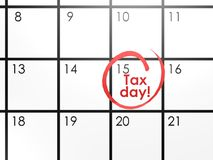 Tax day on white calendar Stock Photos