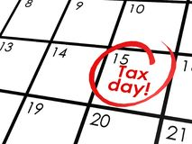 Tax day on white calendar Stock Images