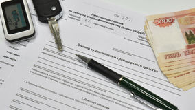 Tax Declaration and Contract of sale of the car. The keys to the car and five thousand notes Royalty Free Stock Photography