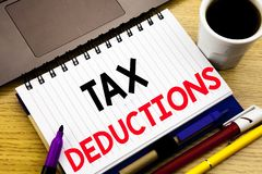 Tax Deductions. Business concept for Finance Incoming Tax Money Deduction written on notebook book on the wooden background in the. Tax Deductions. Business royalty free stock image