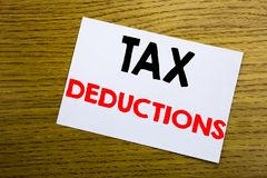 Tax Deductions. Business concept for Finance Incoming Tax Money Deduction written on sticky note, wooden wood background with copy. Tax Deductions. Business Royalty Free Stock Photography