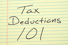 Tax Deductions 101 On A Yellow Legal Pad. The words `Tax Deductions 101` on a yellow legal pad Stock Photos