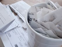 Tax documents and receipts spread on a table Stock Image