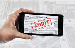 Tax e-file with mobile device Royalty Free Stock Photography