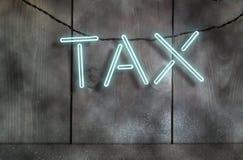 Tax fluorescent neon sign Stock Photo