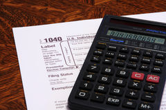 Tax Form 1040. U.S. Income Tax form 1040 and a calculator stock photos