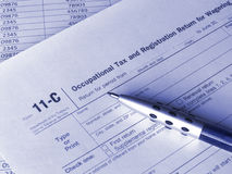 Tax form 11-C. Photo of the United States tax form and pen. Toned blue. Shallow dof Royalty Free Stock Photography
