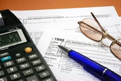 Tax form. S, calculator, pen and glasses Stock Photography
