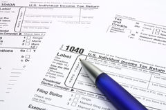 Tax form. S and blue pen Royalty Free Stock Images