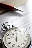 Tax form. Stopwatch and pen Royalty Free Stock Image