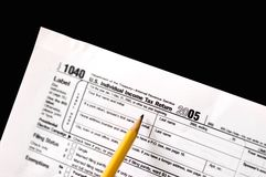 Tax form. A tax form that is blank.  isolated on a black background Royalty Free Stock Photography
