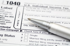 Tax Form. 1040 Tax Form with ballpoint pen. Focus on pen. SDOF. Close-up Royalty Free Stock Photos