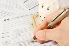 Tax form business financial concept. Hand filling in individual return tax form Stock Image