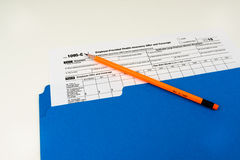 Tax Form 1095-C, Tax Form Details with Light Background Stock Photo