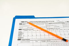 Tax Form 1095-C, Tax Form Details with Light Background Stock Images