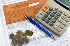 The tax form with calculator, money and pen Royalty Free Stock Photo