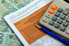 Tax form with calculator, money and pen. Stock Images