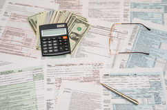 1040 tax form with calculator, pen and dollar Royalty Free Stock Photos